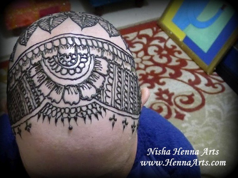henna tattoo on bald head