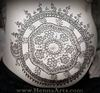 henna design on pregnant belly