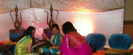ladies doing wedding henna during sangeet